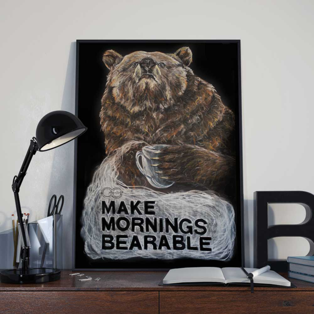 A chalkboard illustration of a bear drinking coffee with the words make mornings bearable written underneath.